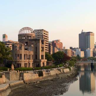 The A-Bomb Dome rising amidst modern and urban Hiroshima