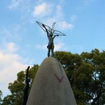 Children's Peace Monument, with little Sadako Sasaki on top (the girl who died from radiation after folding 1,000 paper cranes believing in the belief it would cure her)