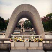 Memorial Cenotaph. You can see the A-Bomb Dome and the Peace Flame through it.