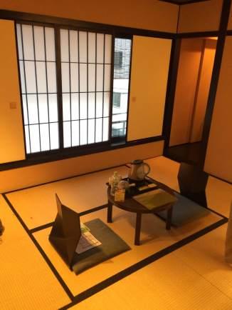 Traditional ryokan room, with tatami mats and miniature tea tables.