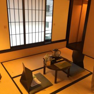 Traditional ryokan room, with tatami mats and miniature tea tables.
