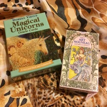 The unicorn oracle cards are more lighthearted, day-to-day advice. The tarot cards offer more in-depth analysis of a situation or life stage.