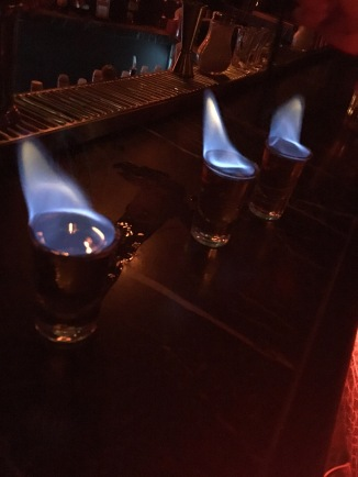 Flaming shots of absinthe