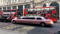 Red double deckers and pink limos
