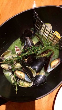Steamed mussels in basil sauce at the Orange