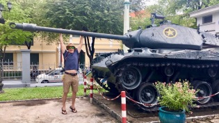 A boy and his tank (allegedly the tank that crashed through the gates at Independence Palace during the fall of Saigon)