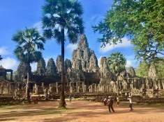 The most distinctive feature of the Bayon is the multitude of serene and smiling stone faces on the many towers
