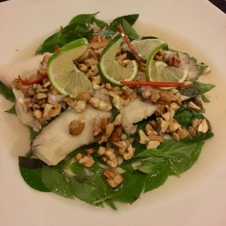 Tonlé Sap Steamed Fish: Bar fish fillet, garlic, shallot, basil, spring onion stem, cashew nut and lime dressing